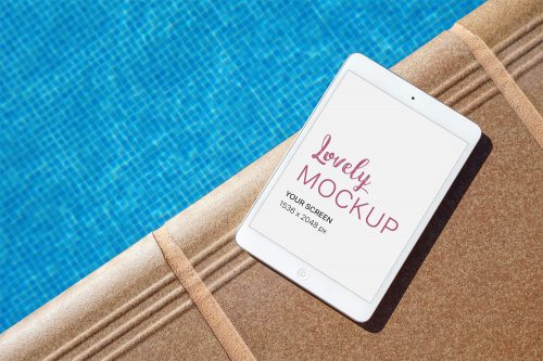iPad near the Pool PSD Mockup