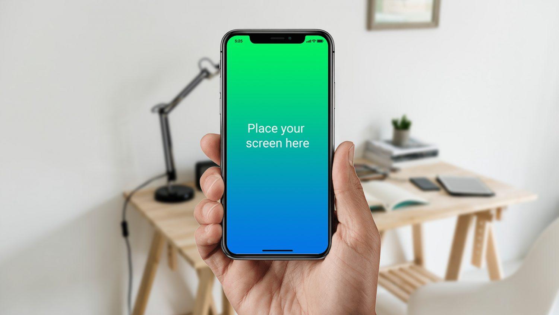 Black iPhone X in Male Hand Mockup