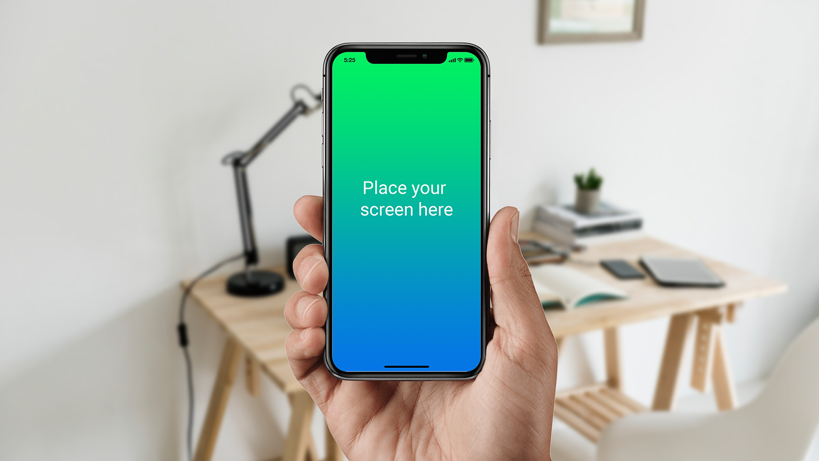 Black iPhone X in Male Hand Mockup