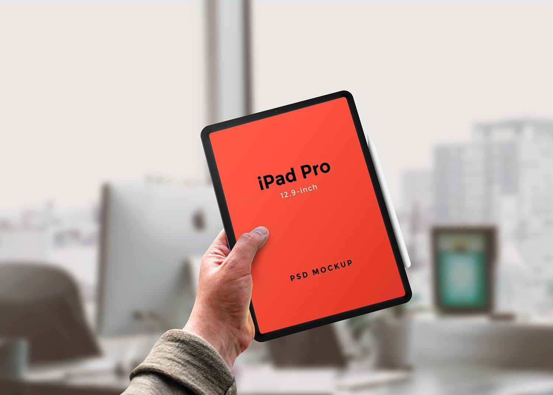 Hand Holding iPad Pro PSD Mockup