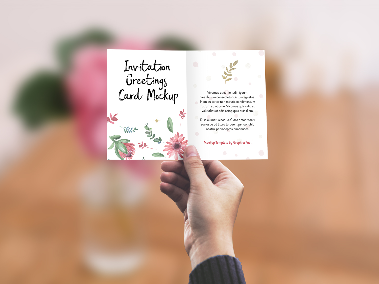 Invitation/Greeting Card in Hand Mockup PSD