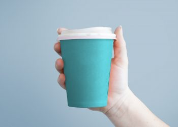 Free Paper Coffee Cup in Hand Mockup PSD
