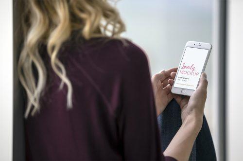 Lady Holding White iPhone Mockup
