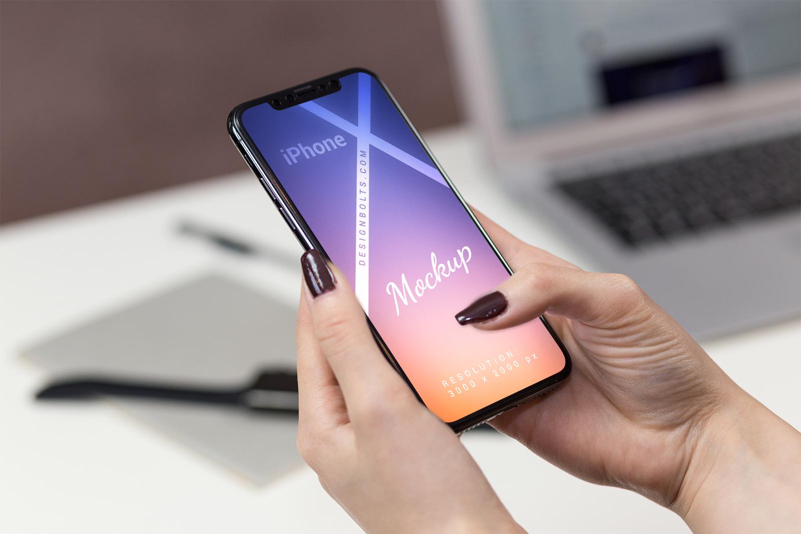 iPhone in Female Hand Mockup