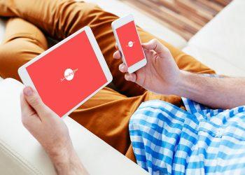 Man Checking His iPad and iPhone Mockup