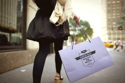 Girl Holding Paper Shopping Bag Mockup