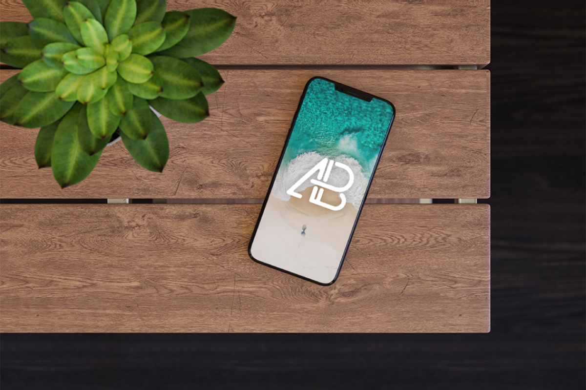 Free iPhone X on Table Mockup
