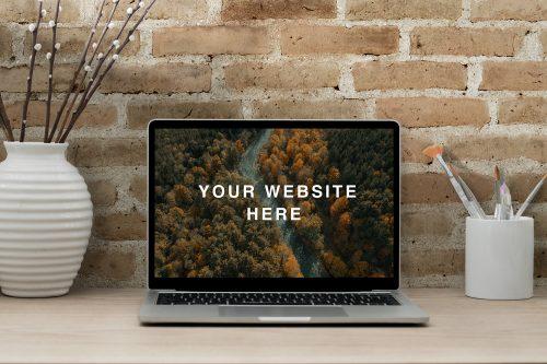 Realistic MacBook Workspace Mockup