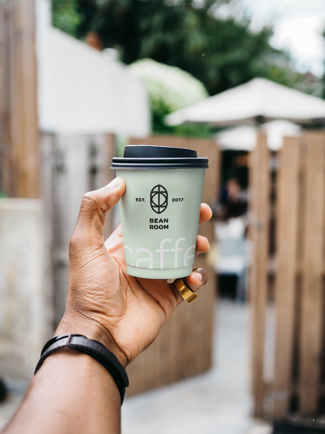 Hand Holding Cup Mockup
