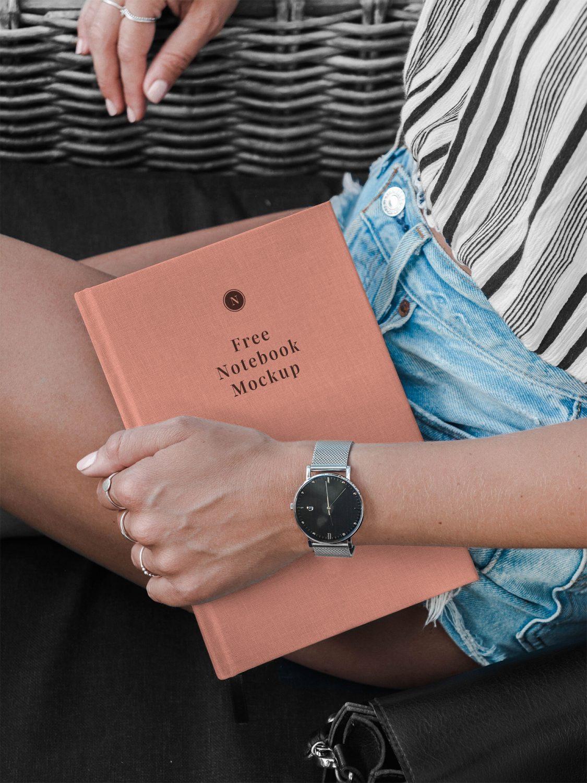 Hand Holding Notebook Mockup