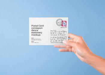 Hand Holding Postal Card Mockup