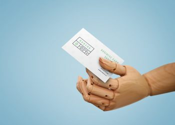 Business Card in Wooden Hand Mockup
