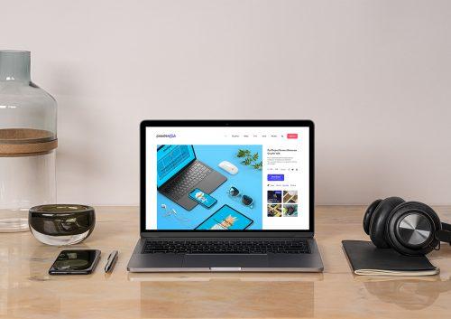 MacBook Pro Mockup on a Desk Workspace Scene